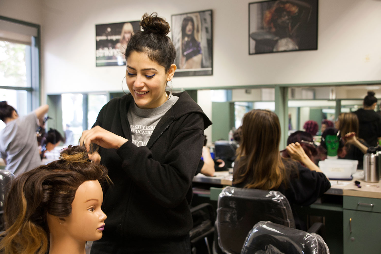 Cosmetology student works during class.