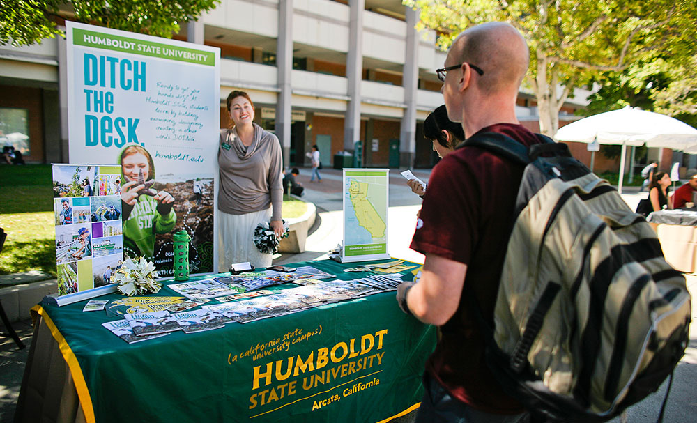 A PCC student speaks with a representative for Humboldt State University.