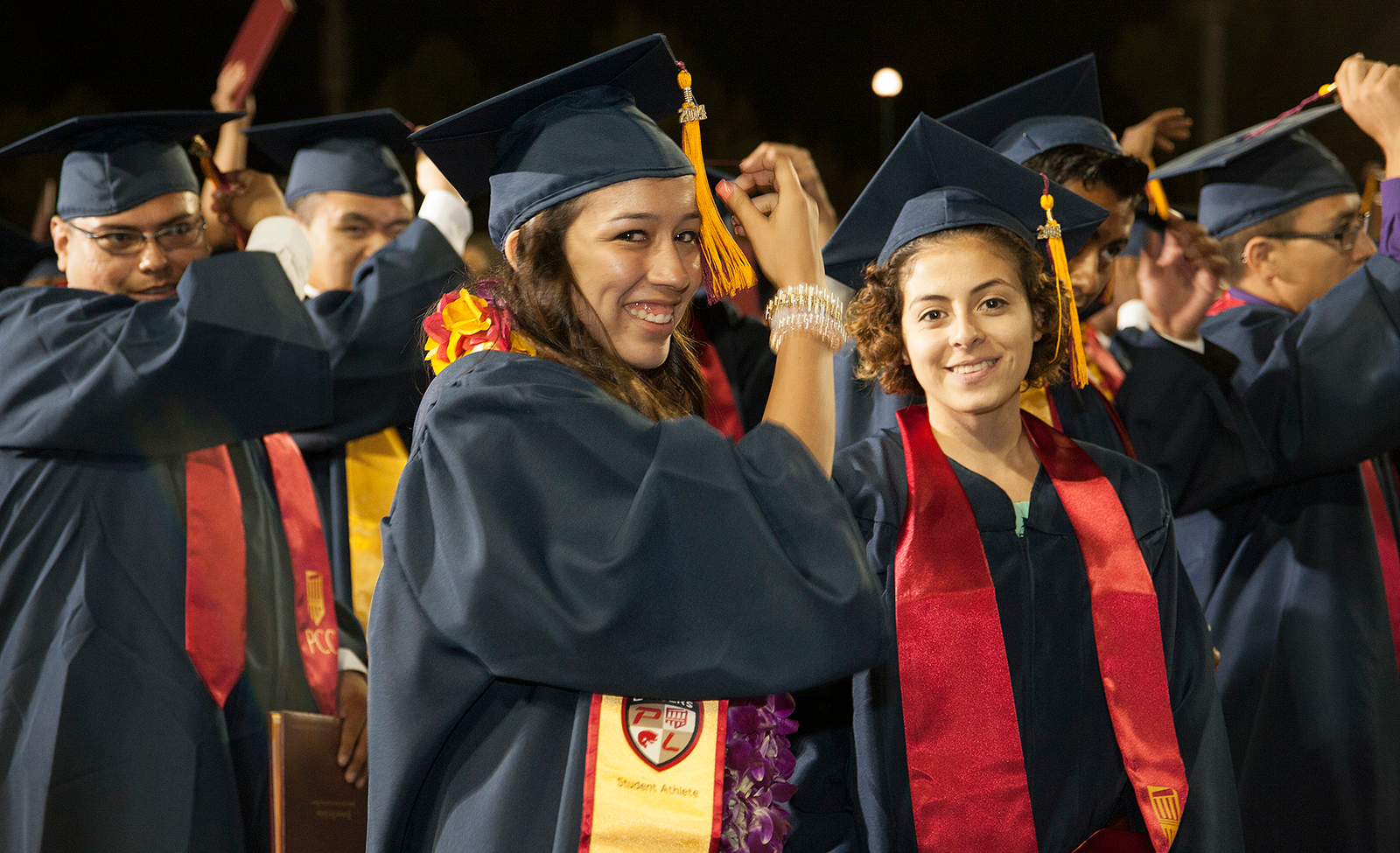 Two students participate in commencement from Pasadena City College.