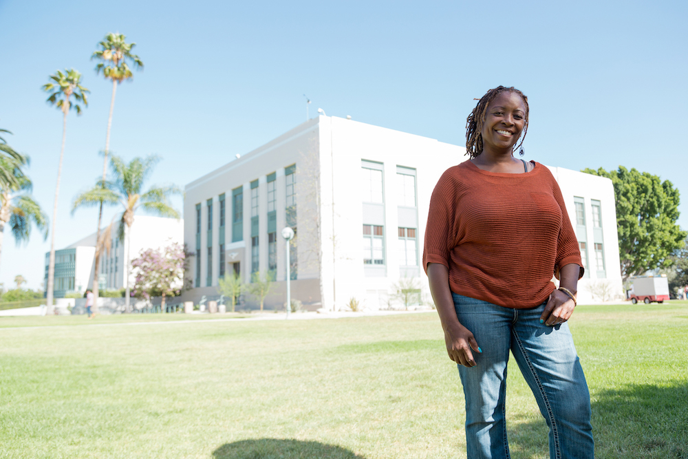 Leah Whetson, a noncredit student, poses in front of the PCC campus.