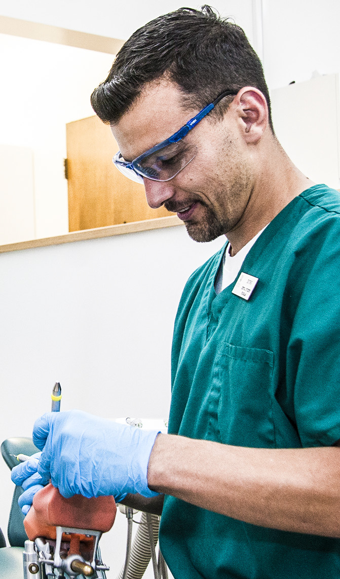 Dental hygiene student receives practical training.