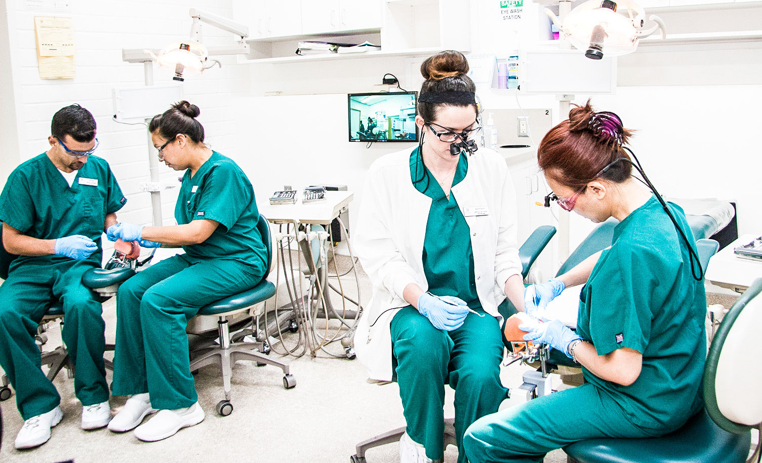 Students get pracitcal training during a denal hygiene class.