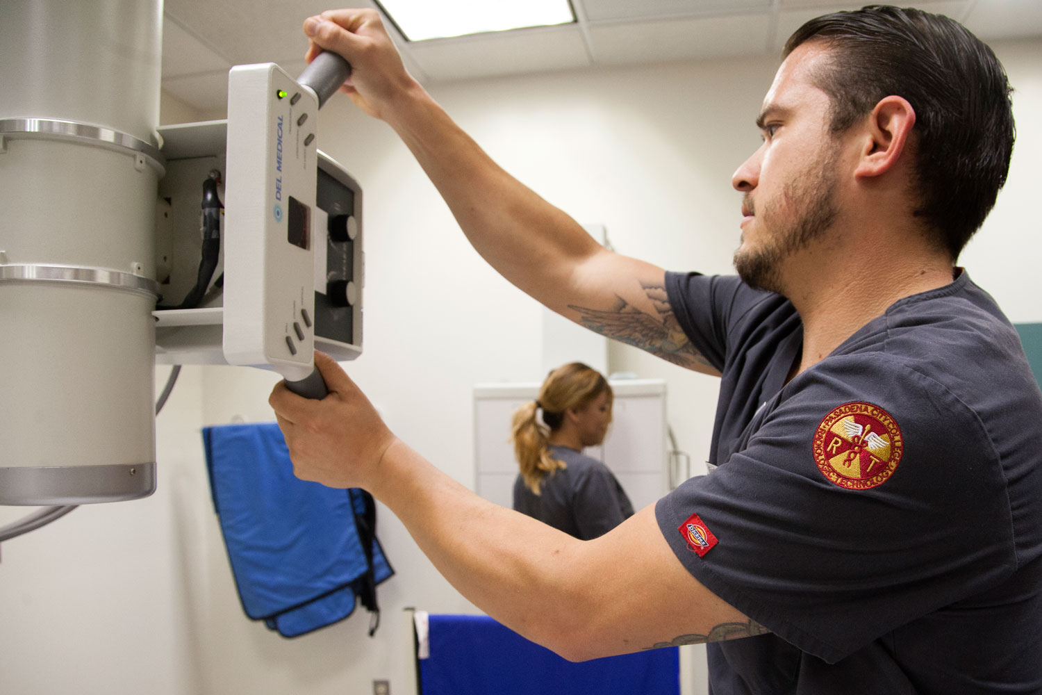 A student gets practical training during a Radiologic Technology course.