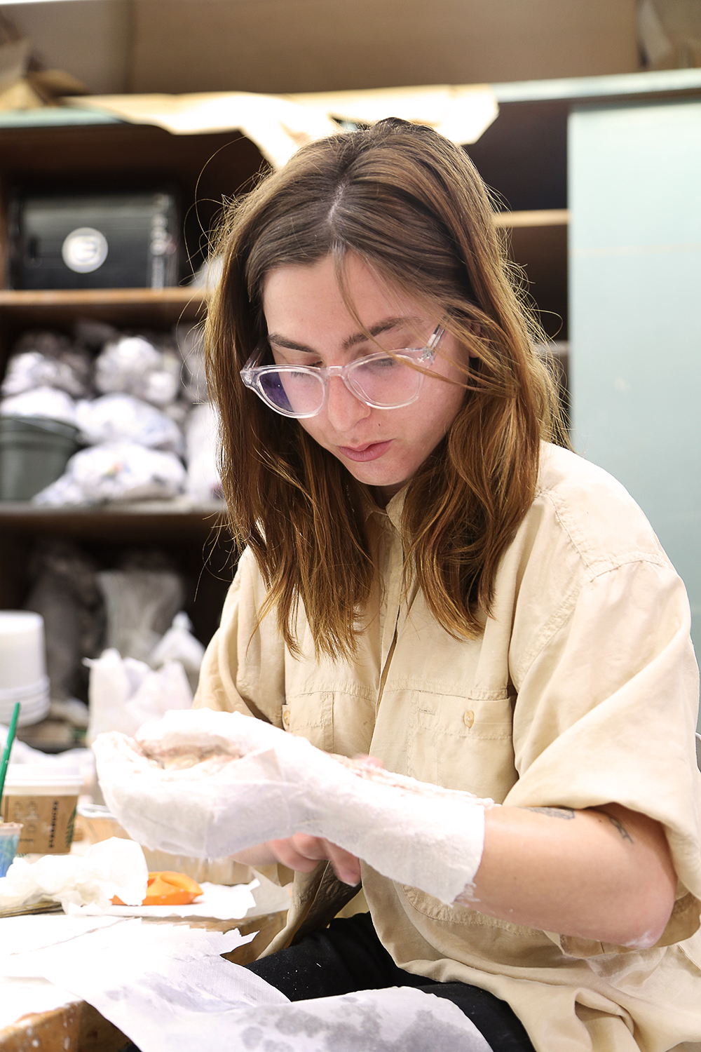 Student works during ceramics class.
