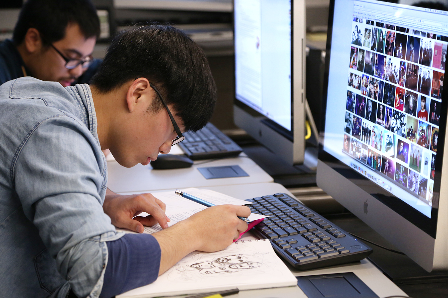 Students work in a graphic design class.