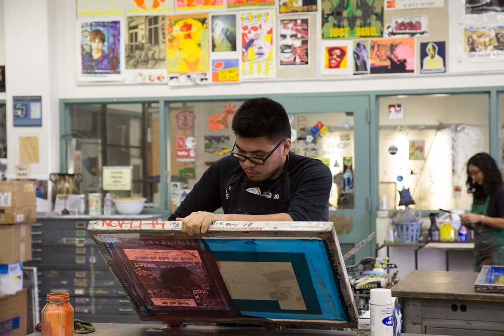 Student works during a screen printing class at PCC.