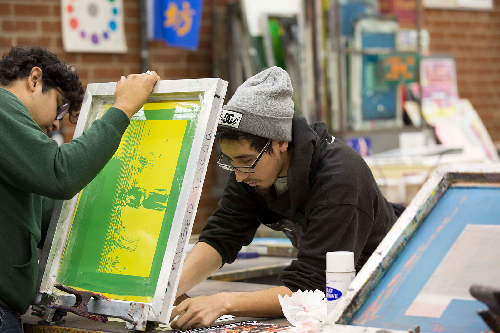 Students work during a screen printing course.