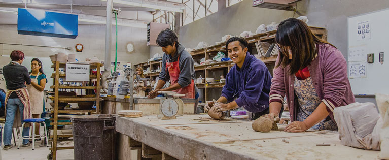 Students work together in a ceramics class.