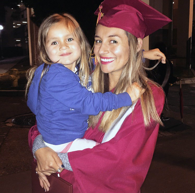 CalWORKs student celebrates her graduation from PCC with her child.