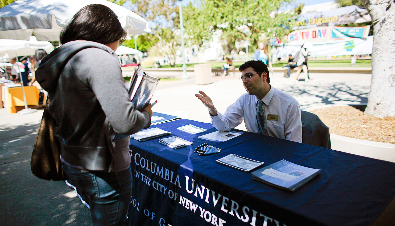 A student speaks with a representative from Columbia University.